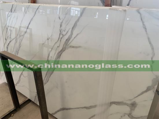 Exquisite and unique Calacatta Nano Glass with its clean whites and striking marble look vein